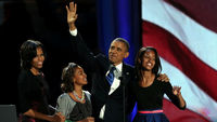 Obama and family on stage in Chicago (getty)