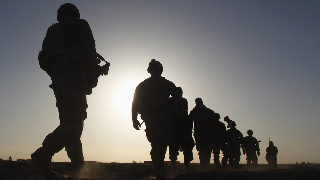 U.S. Army soldiers are silhouetted as they walk during a mission in the Maiwand district of Kandahar province, southern Afghanistan (Reuters)