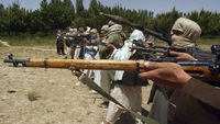 Taliban fighters train with their weapons in an undisclosed location in Afghanistan (Reuters)
