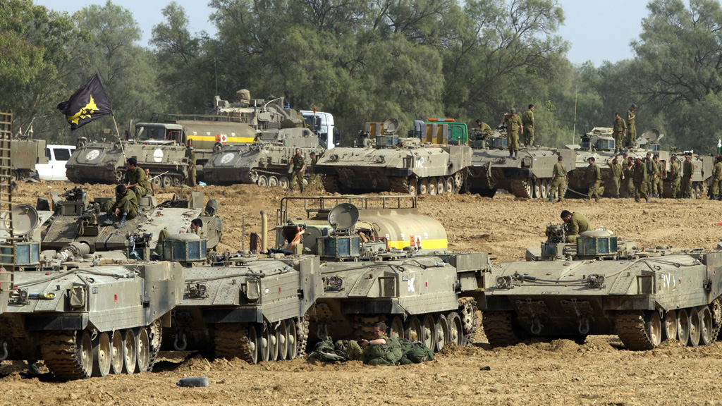 Israeli armoured personnel carriers near the border with the gaza strip (Getty)