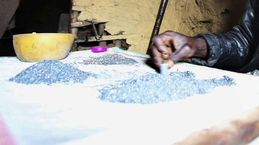 A man sorts the mineral coltan and tin ore in eastern Congo (Reuters)