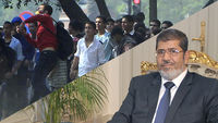 Mursi and protestors (Reuters)