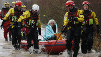 90-year-old Diana Mallows is rescued from her flooded home in Somerset (pic: Reuters)