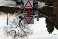 Severe warnings of potential danger to life are issued for Wales as footage shows submerged homes, roads and cars. Meanwhile, travellers in the north east and western England suffer travel chaos.