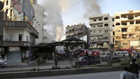More than 30 people were reported killed in two car-bomb attacks in an area of Damascus reportedly under government control
