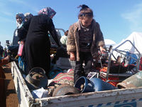 Alex Thomson captures the challenging conditions facing thousands of refugees in Atmeh, northern Syria.