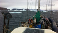 SV Gambo isn't your typical research vessel. There's cod and halibut drying in the rigging and two huskies Ukioq and Nuliaq howling on the decks. Science Editor Tom Clarke reports from Greenland.