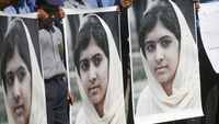 Pakistanis rally in support of Malala Yousufzai (Reuters)