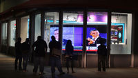 Crowd watching debate on TV through a window (getty)