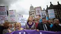 Campaigners against welfare cuts at a 2011 march (Getty)
