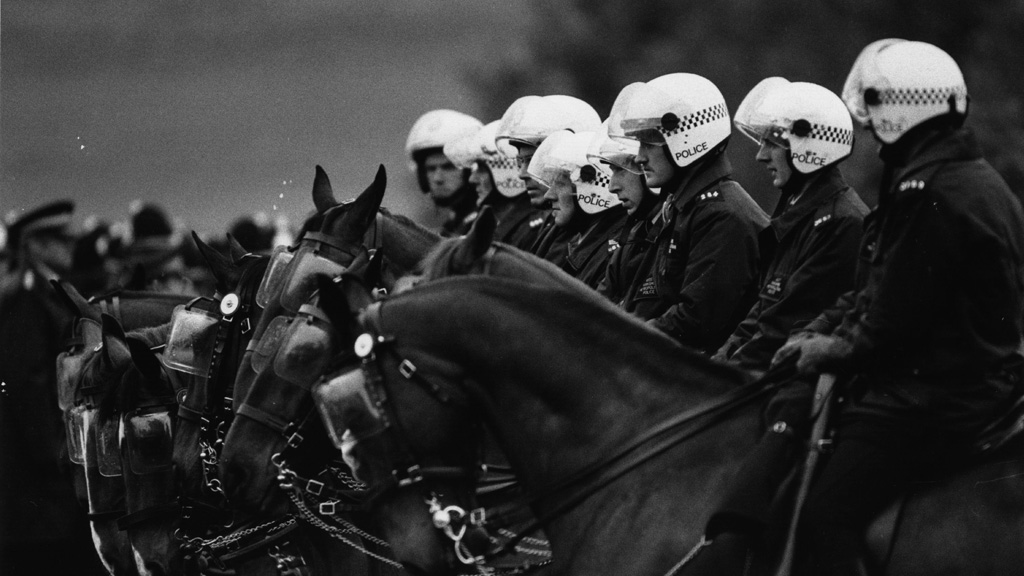 Police on horseback line up outside the Orgreave coking plant in South Yorkshire during the miners strike (Getty)
