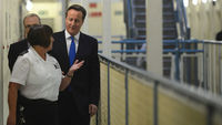 David Cameron tours a prison on Monday 22 October 2012 (Reuters)