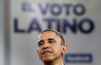 President Obama with voto Latino logo (reuters)