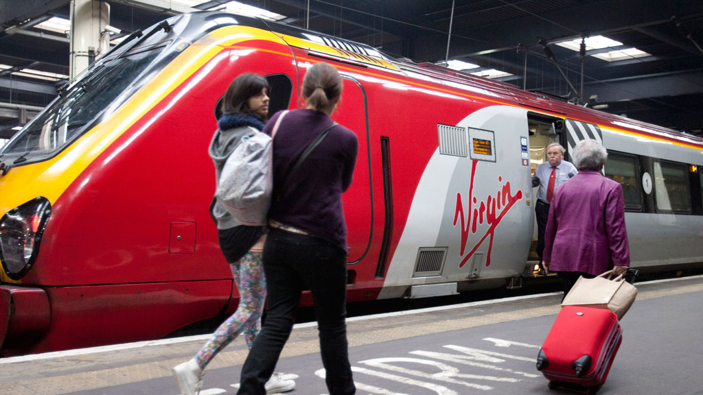Civil servant failures over the west coast rail contract will cost taxpayers tens of millions of pounds, a report by MPs reveals.