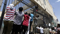 Hundreds of protesters storm the US embassy in Yemen chanting