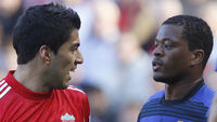 Luis Suarez and Patrice Evra (Reuters)