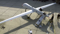 A US drone is prepared for flight on a runway. (Reuters)