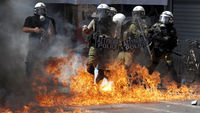 riot police and flames in athens (reuters)