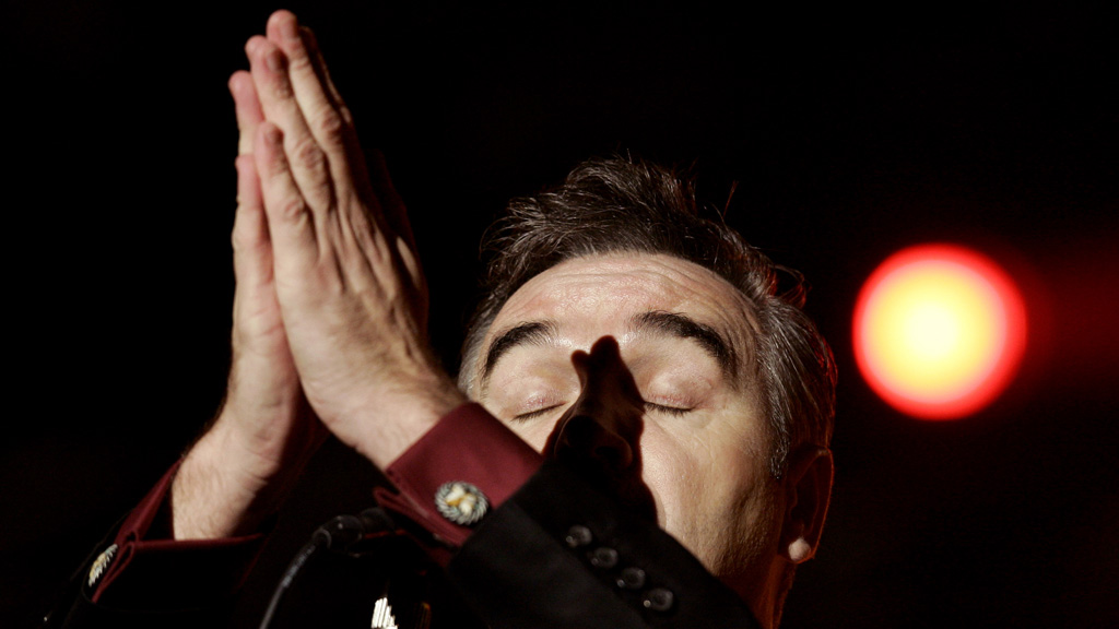 Morrissey 'prays' during a performance in Paris in 2006. (Reuters)