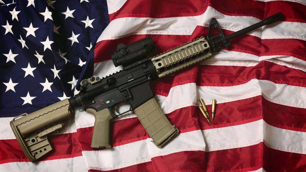 US flag and gun (getty)