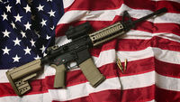 US flag and gun (getty)