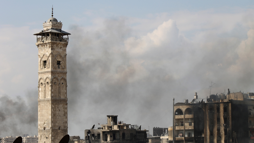 Video footage released by activists shows Syrian rebels fighting inside the Great Umayyad Mosque of Aleppo immediately after its famous minaret is destroyed.
