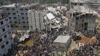 More than 70 people are killed on the outskirts of the Bangladeshi capital Dhaka after a building collapses (picture: Reuters)