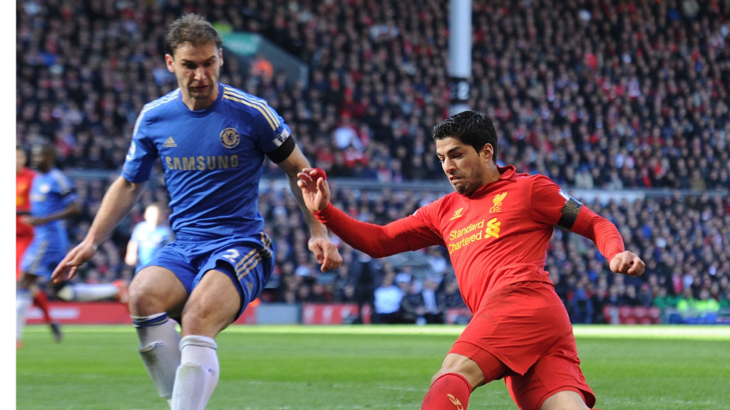 The Liverpool striker Luis Suarez is banned for ?? matches by the FA after accepting a charge of violent conduct for biting Chelsea defender Branislav Ivanovic (Getty)