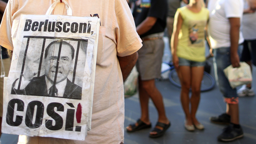 Anti-Berlusconi protesters outside court (Reuters)