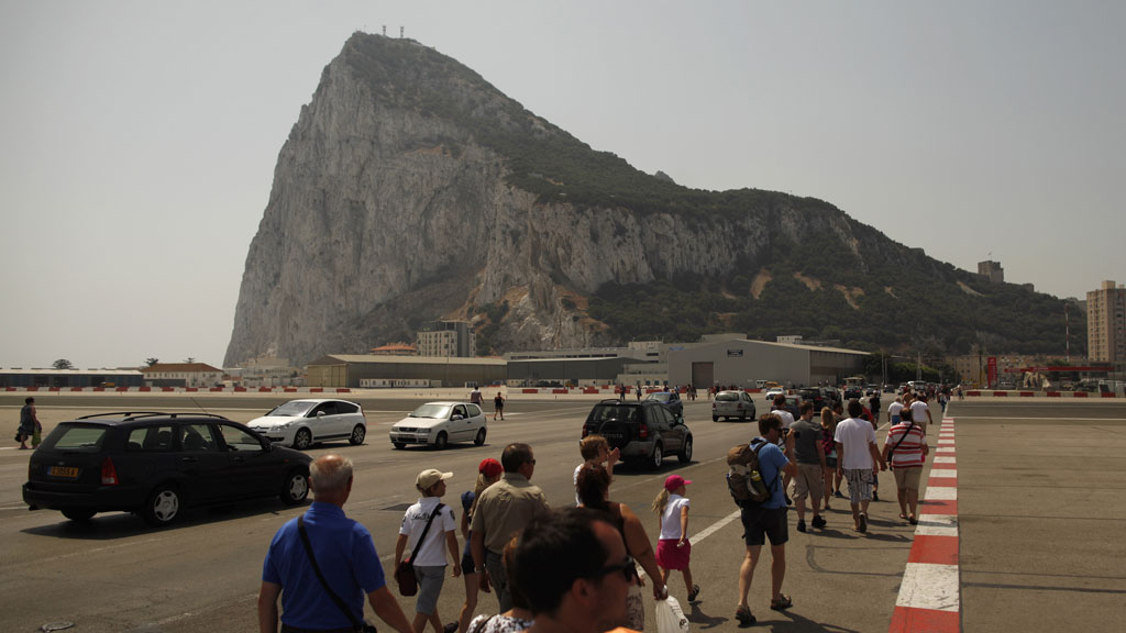 Pedestrians and drivers cross the Spanish border into Gibraltar (pic: Reuters)