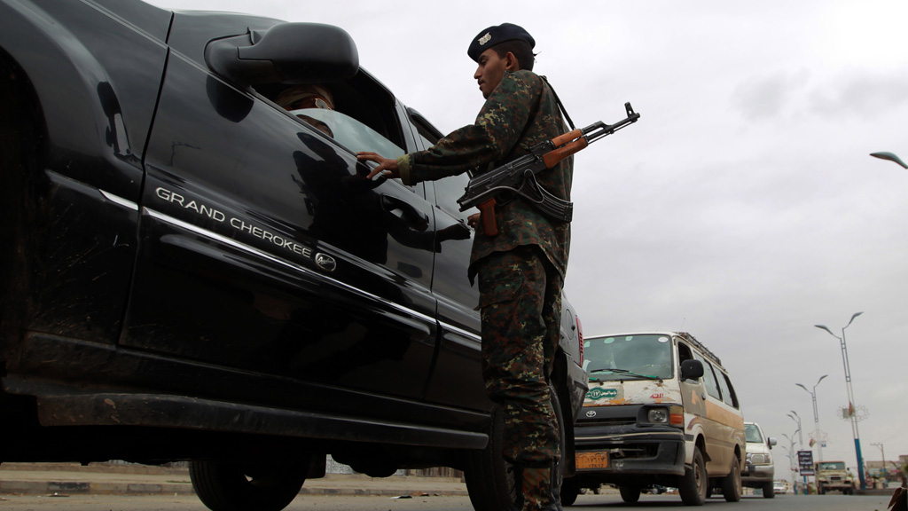 A Yemeni soldier checks a car close to the US embasssy in Sana'a (pic: Getty)