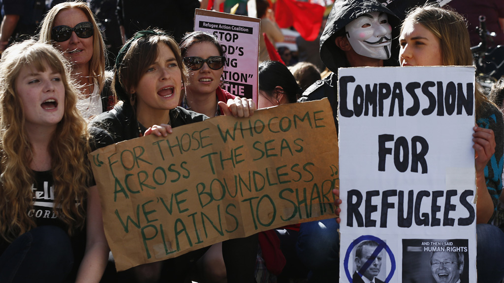 Protestors against Australian immigration policy outside the televised debate (picture: Reuters)