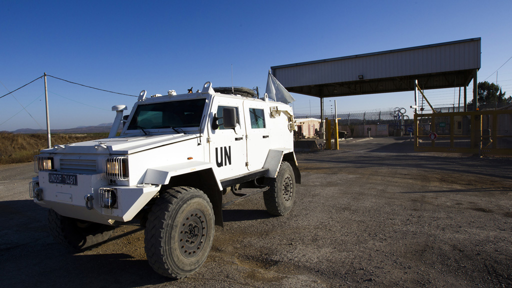 UN vehicles cross from Syria to Lebanon (Reuters)