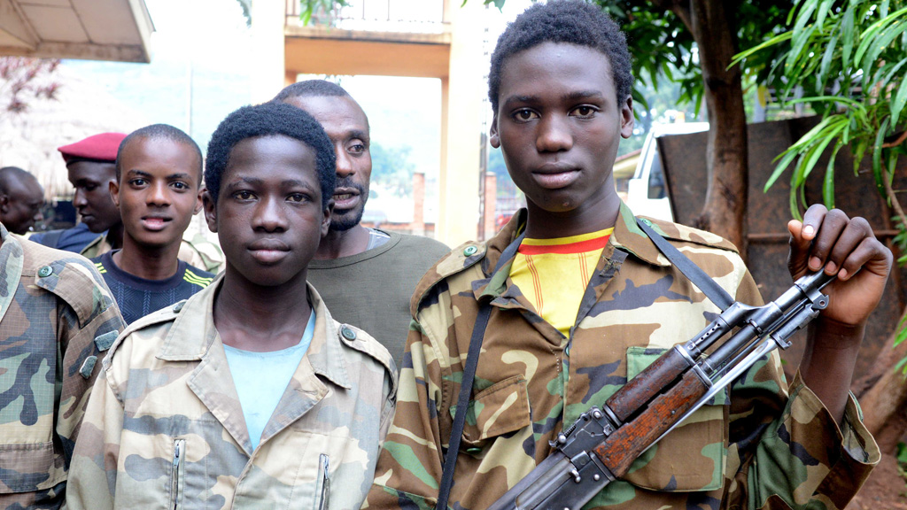 Young Seleka fighters pose at a Seleka base in Bangui on 25 July 2013. (picture: Getty)