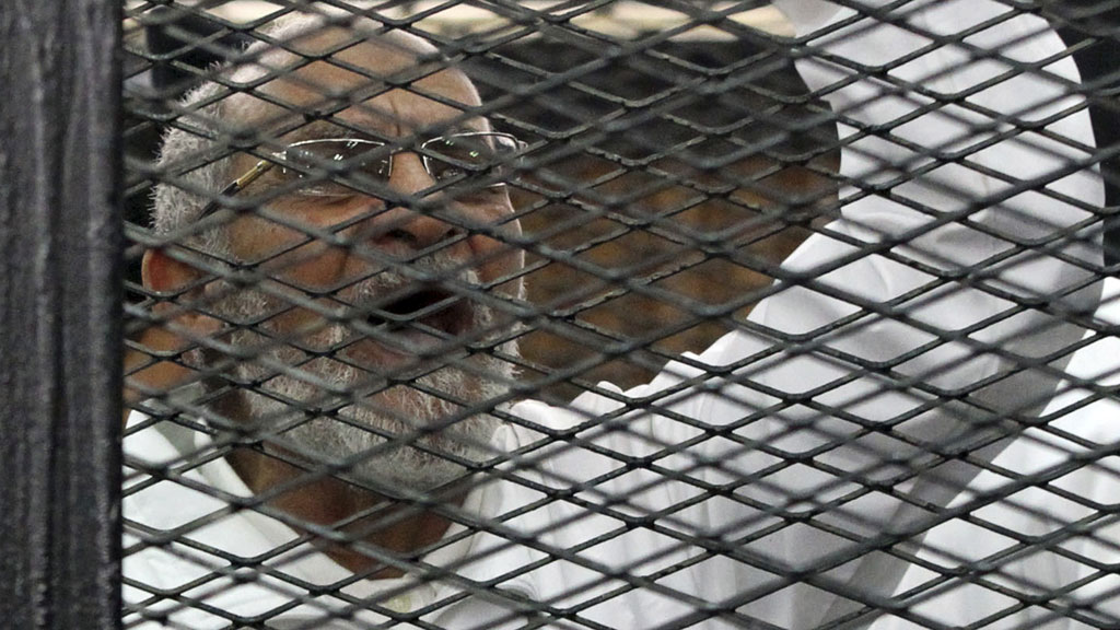 Muslim Brotherhood leader Mohammed Badie (R)