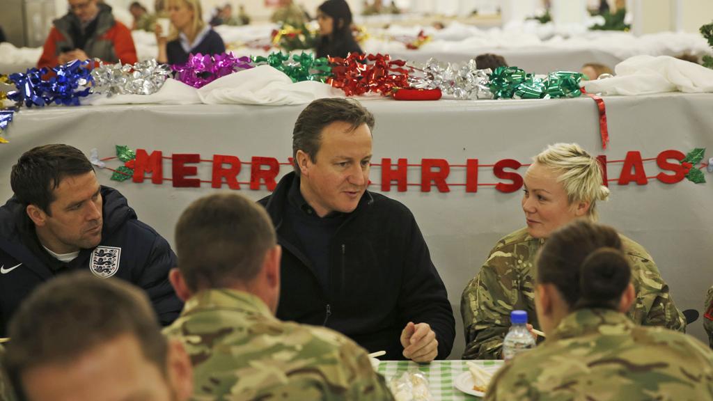 Prime Minister David Cameron (R)
