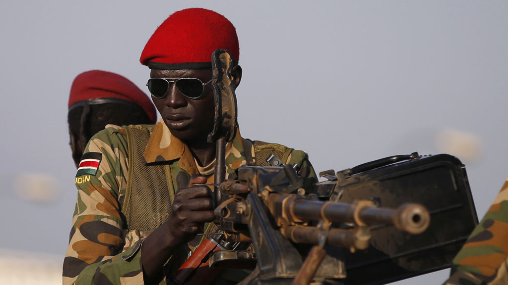 SPLA soldiers stand in a vehicle in Juba, South Sudan (R)