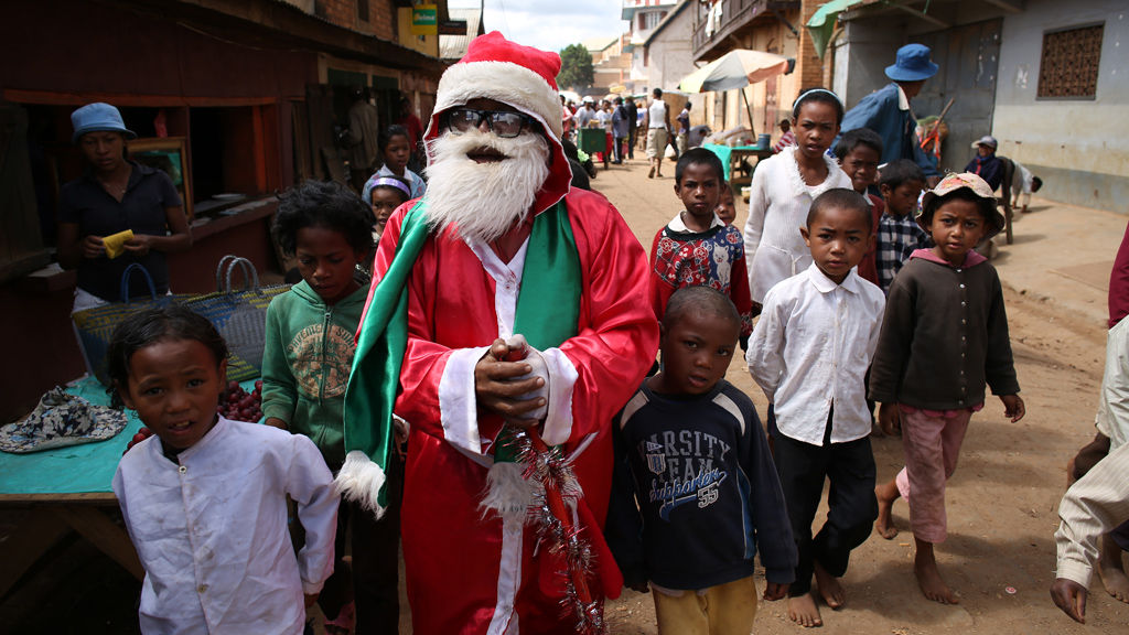 Madagascar Father Christmas walks in the dusty street of Ambohibary ...