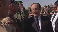 French president Francois Hollande is welcomed off his plane in Mali by members of the military (picture: Reuters)