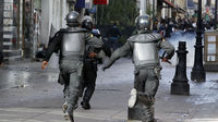 Riot police run at protestors in Tunisia (Reuters)