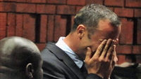 Oscar Pistorius breaks down in tears as he appears in court charged with murdering his girlfriend Reeva Steenkamp. The Paralympic star disputes the charge