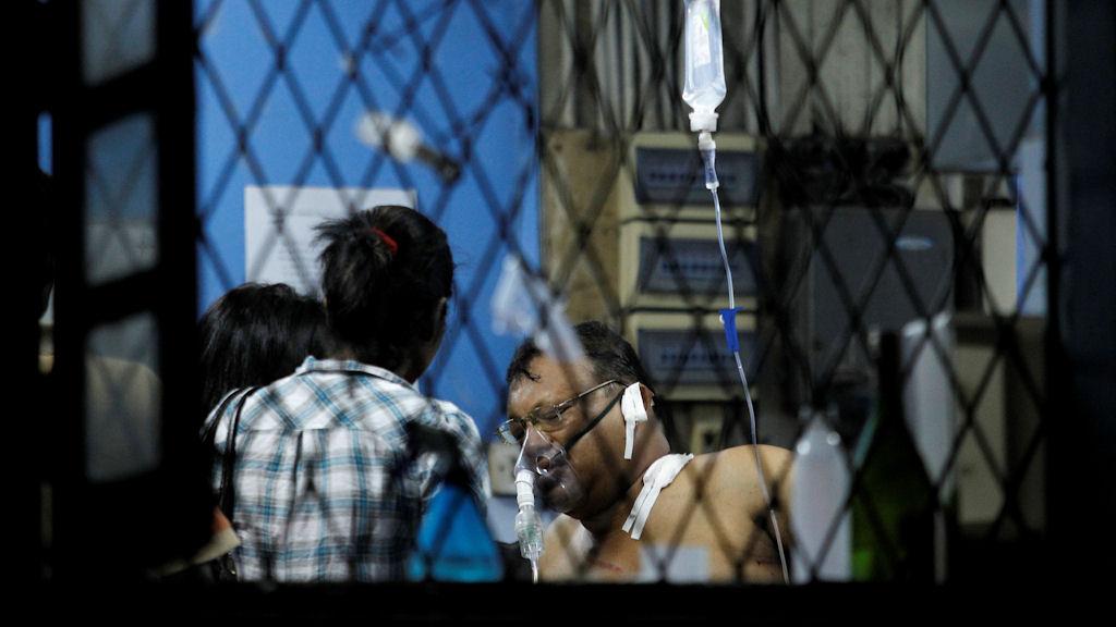 Faraz Shauketaly, Sri Lankan journalist, makes statement after being shot (Getty)