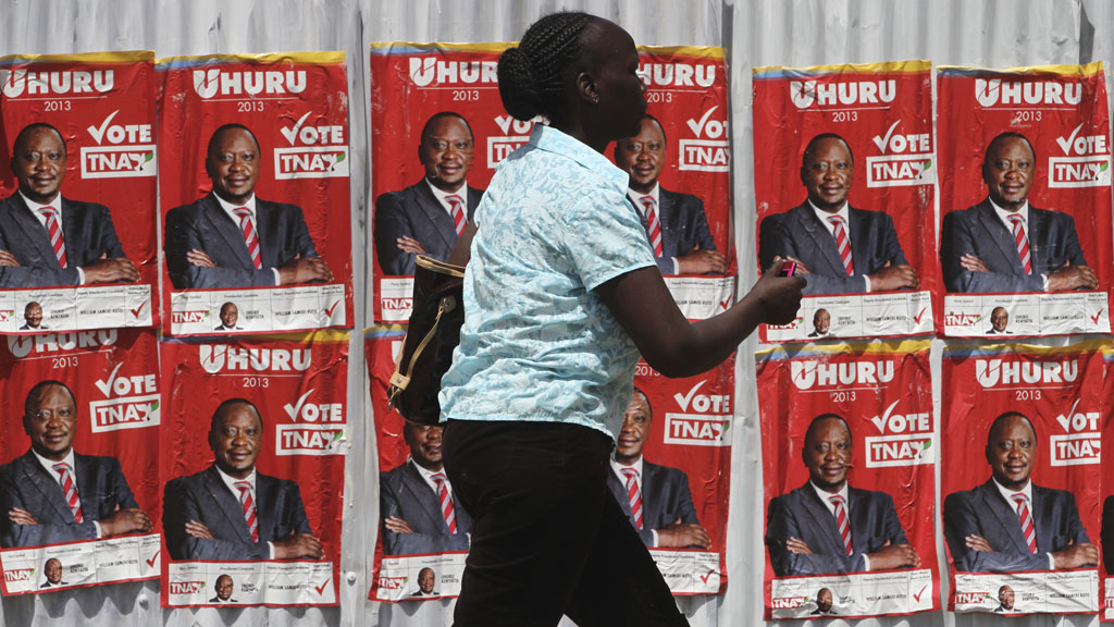 A woman walks by posters of Kenya's deputy prime minister Uhuru Kenyatta in Nairobi (pic: Reuters)