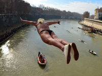 Maurizio Palmulli of Italy dives into Rome's river Tiber as part of traditional new year celebrations (Getty).