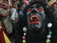 A reveler dressed as a demon reacts as he performs during the 29th Cochin Carnival at Fort Kochi in India (Reuters).