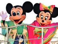 Disney characters Mickey and Minnie Mouse, dressed in traditional Japanese kimonos, wave to greet guests from a float during the theme park's annual new year's day parade (Getty).