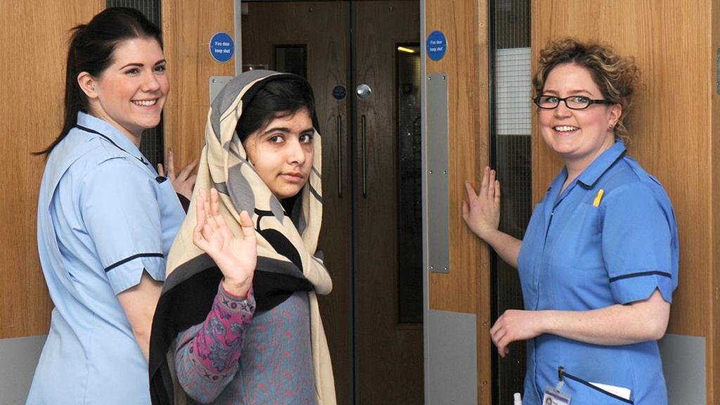 Malala Yousafzai waves as she leaves Birmingham's Queen Elizabeth Hospital (Reuters)