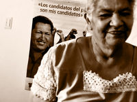 Teofila Medina lives rent-free in a Chavez apartment, as he looks over her shoulder (all rights reserved Dai Baker).