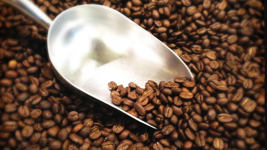 coffee beans with scoop (getty)