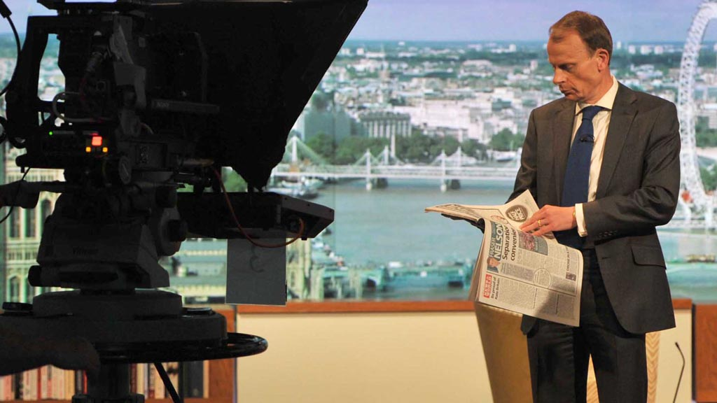 Andrew Marr reading a newspaper on The Andrew Marr Show (picture: Reuters)